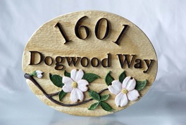 hand carved house sign