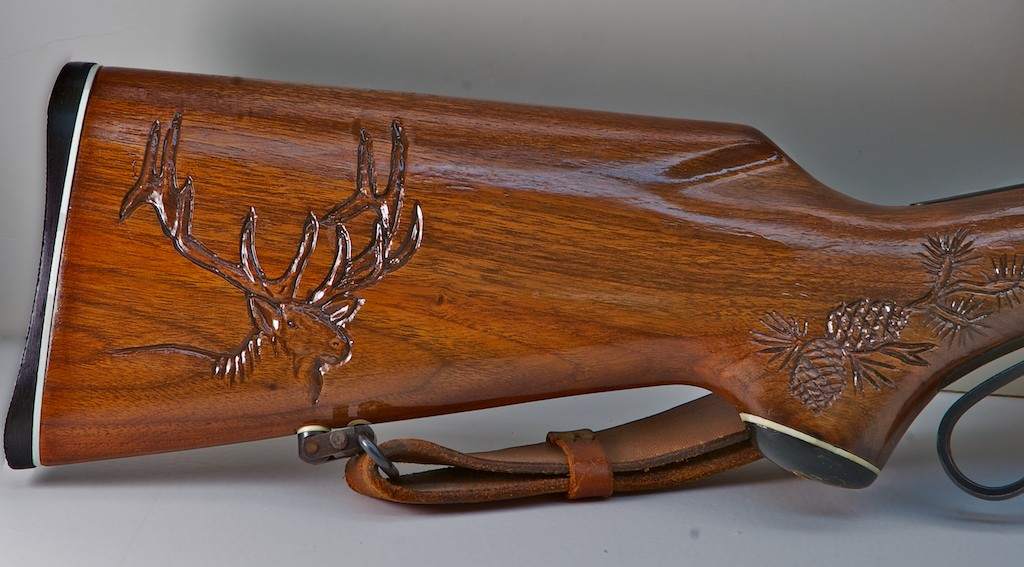 handcarved rifle stock