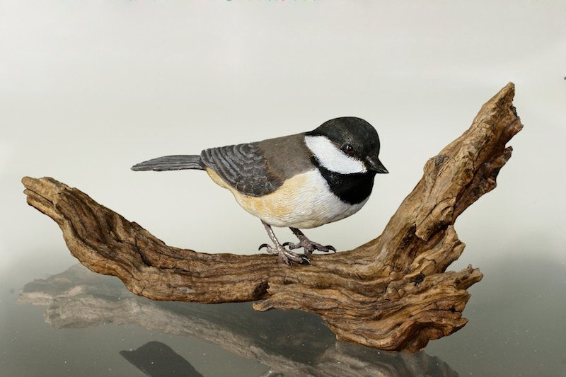 handcarved chickadee on driftwood