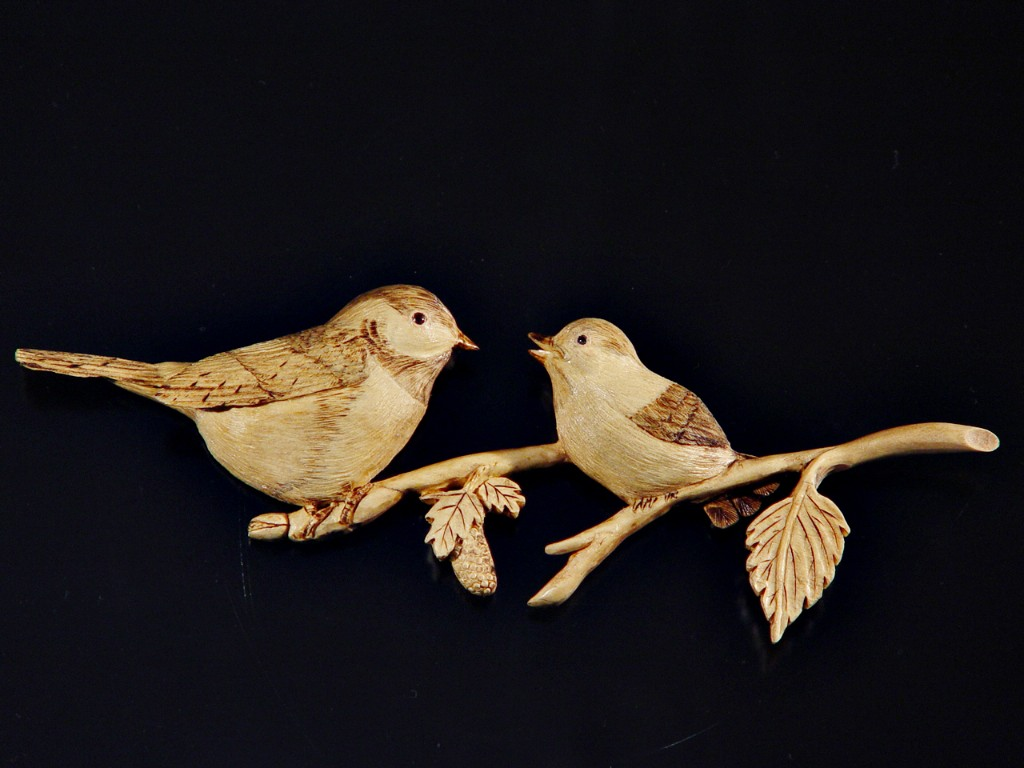 handcarved chickadee with chick