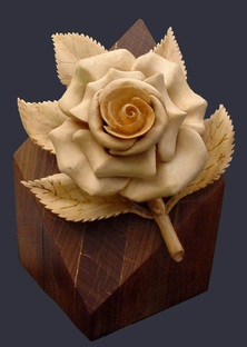 hand carved basswood rose on an Ipe base