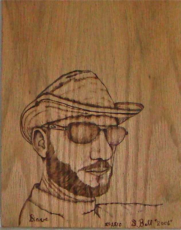 wood burned portrait from a photo