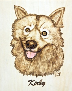 wood burned dog portrait from a photo