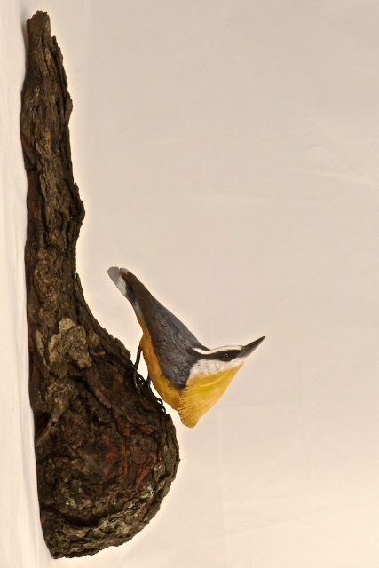 handcarved red-breasted nuthatch