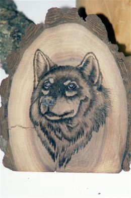 wood burned wolf on a black walnut slab